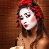 Kvinna i traditionell östlig dräkt arkivfoton