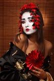 Kvinna i traditionell östlig dräkt royaltyfri bild