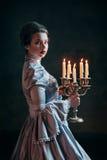Kvinna i Victorianklänning arkivbild