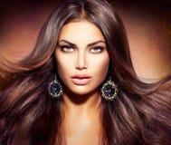 Kvinna med att blåsa hår Fotografering för Bildbyråer