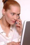 Kvinna med bärbar dator och mobil Royaltyfria Bilder