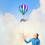 Kvinna med ballongen Fotografering för Bildbyråer