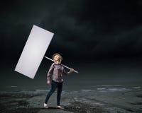 Kvinna med banret Fotografering för Bildbyråer