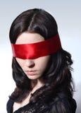 Kvinna med blindfolder Royaltyfri Foto