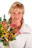 Kvinna med blommor Royaltyfri Foto