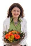 Kvinna med blommor Royaltyfria Bilder