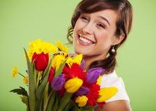 Kvinna med blommor Arkivfoton