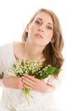 Kvinna med blommor Arkivfoto