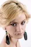 Kvinna med blont hår och smink Arkivbilder
