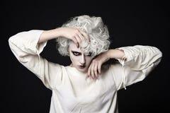 Kvinna med clownsminket för halloween Royaltyfri Foto
