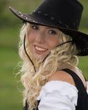 Kvinna med cowboyhatten royaltyfri bild