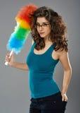 Kvinna med dammtrasan, studioskott Arkivfoto