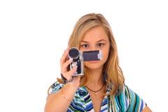 Kvinna med den digitala camcorderen Arkivfoto