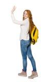 Kvinna med den isolerade ryggsäcken Royaltyfri Bild
