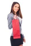 Kvinna med den röda shoppingpåsen Fotografering för Bildbyråer