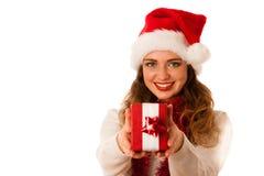 kvinna med den Santa Claus hatten som firar christmass Royaltyfria Bilder
