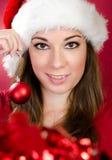 Kvinna med den Santa hatten royaltyfri bild
