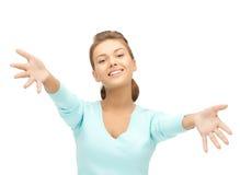 Kvinna med en öppen hand som är klar för att krama Fotografering för Bildbyråer