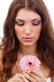 Kvinna med en blomma Royaltyfri Foto