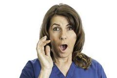 Kvinna med en chockad framsida Royaltyfri Foto