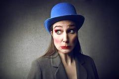 Kvinna med en hatt Arkivbild