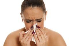 Kvinna med en influensa fotografering för bildbyråer