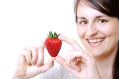 Kvinna med en jordgubbe royaltyfria bilder
