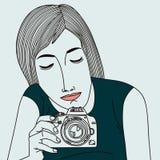 Kvinna med en kamera Royaltyfria Foton