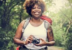 Kvinna med en parallell kamera royaltyfri foto
