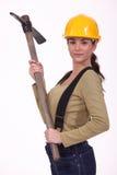 Kvinna med en pickaxe Fotografering för Bildbyråer