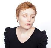 Kvinna med ett SAD uttryck som isoleras på white Royaltyfri Fotografi