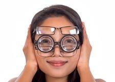 Kvinna med exponeringsglas Arkivbild