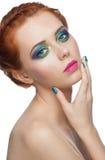 Kvinna med färgrik makeup royaltyfria foton