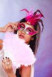 Kvinna med fanen för karnevalmaskeringshåll Fotografering för Bildbyråer
