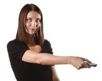 Kvinna med fjärrkontrollen Royaltyfri Fotografi