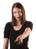 Kvinna med fjärrkontrollen Fotografering för Bildbyråer