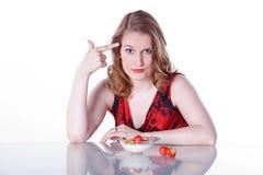 Kvinna med frukostsädesslag Arkivbilder