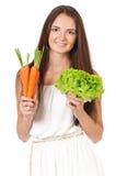 Kvinna med grönsaker Arkivfoto