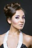 Kvinna med härlig makeup och hår Royaltyfri Bild