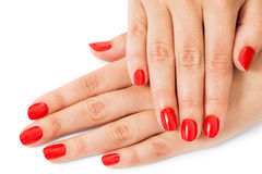 Kvinna med härliga manicured röda fingernaglar Arkivfoton