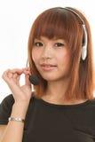 Kvinna med hörlurar med mikrofon Royaltyfria Foton