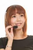 Kvinna med hörlurar med mikrofon Arkivbilder