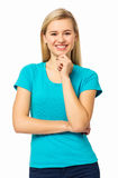 Kvinna med handen på Chin Against White Background Royaltyfri Foto
