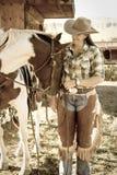 Kvinna med henne häst Fotografering för Bildbyråer