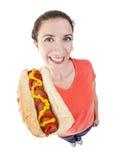 Kvinna med hotdogen Arkivfoto