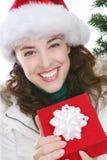 Kvinna med julklapp Royaltyfria Bilder