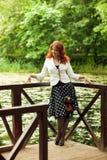 Kvinna med kameran Royaltyfria Bilder