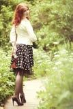 Kvinna med kameran Arkivbild