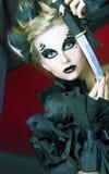 Kvinna med kniven Arkivbild
