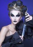 Kvinna med kniven Royaltyfri Fotografi